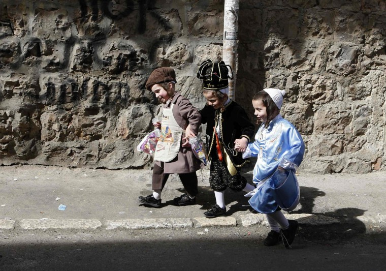 Boys wear costumes ahead of the Jewish holiday of Purim in Jerusalem's Mea Shearim neighborhood. Purim, which will be marked next week, is a celebration of the Jews' salvation from genocide in ancient Persia, as recounted in the Book of Esther. (Baz Ratner/Reuters)