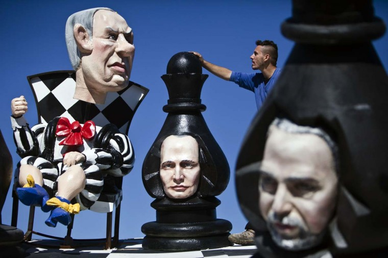 An employee stands near sculptures, one of them depicting Israeli Prime Minister Benjamin Netanyahu (L), at a factory near Kfar Saba that manufactures floats for the annual Purim parade in Holon, February 3, 2013. The holiday of Purim is a celebration of the Jews' salvation from genocide in ancient Persia, as recounted in the Book of Esther, and will be marked on February 24, 2013. (Nir Elias/Reuters)