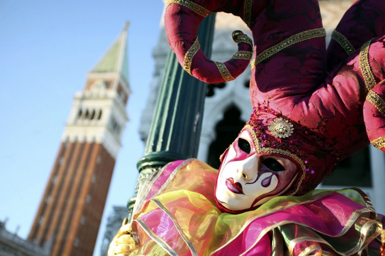 A masked reveller poses in Saint Mark's Square during the Venetian Carnival in Venice February 3, 2013. (Manuel Silvestri/Reuters)