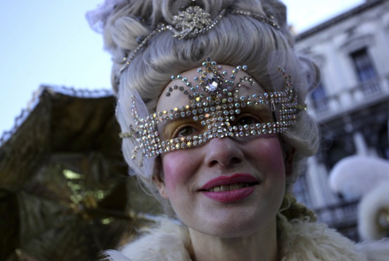 A woman dressed in traditional costume looks on during the Venetian Carnival in Saint Mark's square in Venice February 3, 2013. (Manuel Silvestri/Reuters)