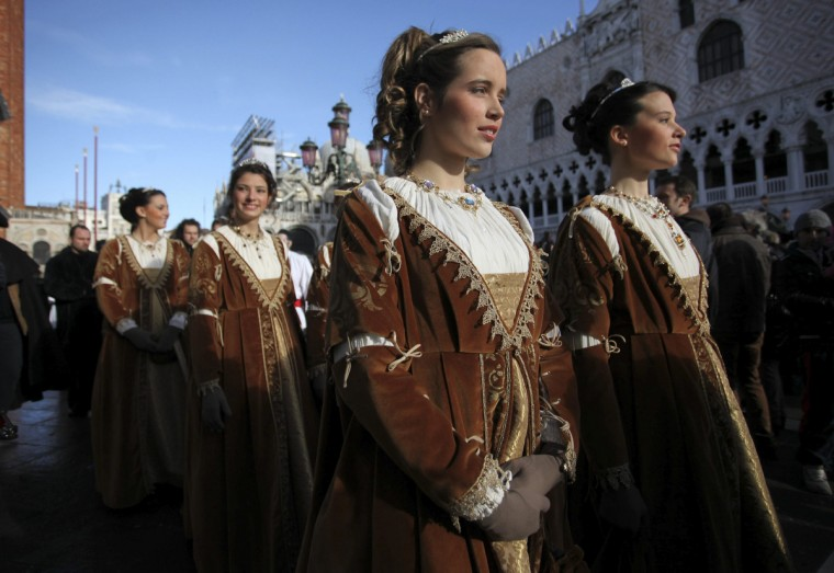 Women dressed in traditional costumes pose during the Venetian Carnival in Saint Mark's square in Venice February 3, 2013. (Manuel Silvestri/Reuters)
