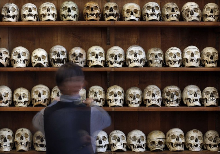 A staff member arranges skulls at Lombroso Museum in Turin January 28, 2013. Many of the body parts on display in the museum were taken from prisons without any permission from family members. Now hundreds of years later some distant relatives and local communities are saying it is time to get the body parts back. (Stefano Rellandini/Reuters)