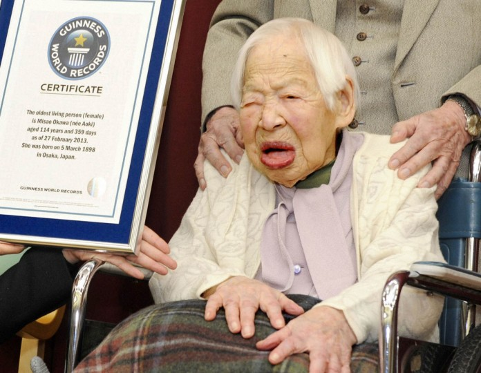 Misao Okawa (R) receives a certification from an official of Guinness World Records in Osaka, western Japan, in this photo taken by Kyodo. Okawa of the western Japanese city of Osaka was on Wednesday officially recognised by the Guinness World Records as the oldest woman alive at 114 years old. Born to a clothing merchant in 1898, also the year of the Spanish-American war, Okawa is due to celebrate her 115th birthday next week on March 5th. (Kyodo/Reuters)
