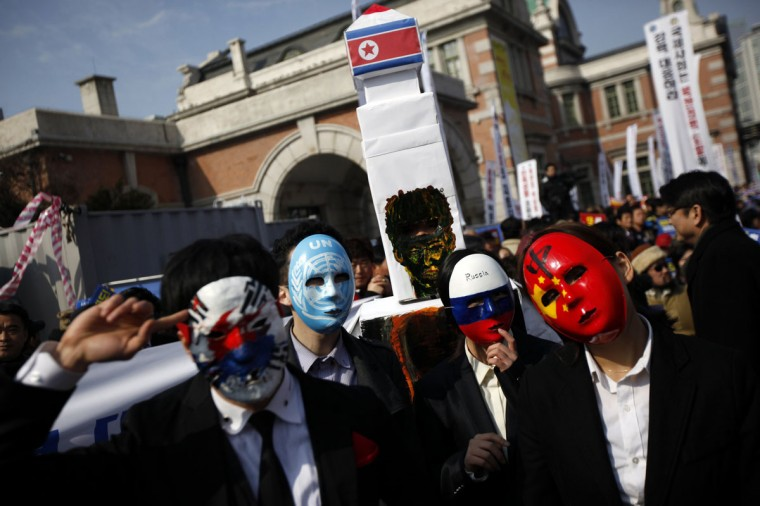 "Korea Freedom Federation's members wearing masks featuring national flags and carrying a mock North Korean missile (C) pose for a photo during a rally denouncing North Korea's third nuclear test in front of a railway station in Seoul. North Korea has bolstered its defences against a ""hostile"" U.S. with its third nuclear test, it said on Thursday, noting that countries that had bowed to U.S. pressure to abandon their nuclear plans had suffered ""tragic consequences"". North Korea carried out its largest nuclear test to date last week. (Kim Hong-Ji/Reuters)"