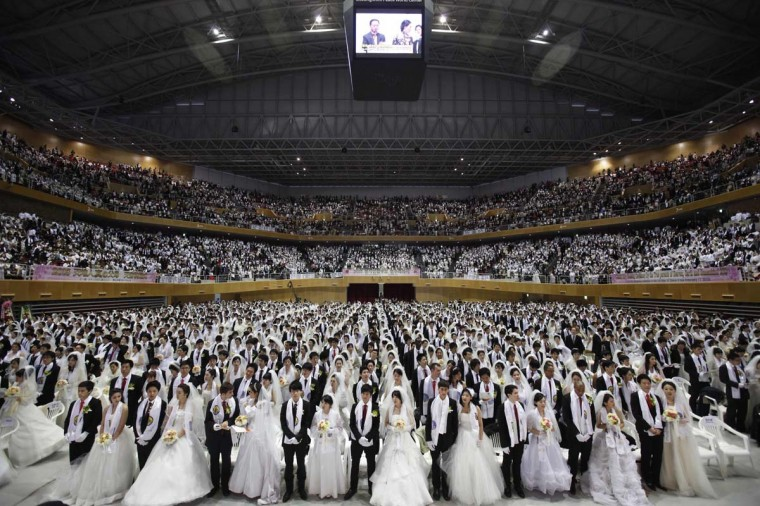 Thousands of newlyweds attend a mass wedding ceremony of the Unification Church at Cheongshim Peace World Centre in Gapyeong, about 37 miles northeast of Seoul on February 17, 2013. The Unification Church founded by evangelist reverend Moon Sun-myung in Seoul in 1954, performed its first mass wedding in 1961 with 33 couples. Approximately 3,500 couples attended the mass wedding on Sunday. (Kim Hong-Ji/Reuters)