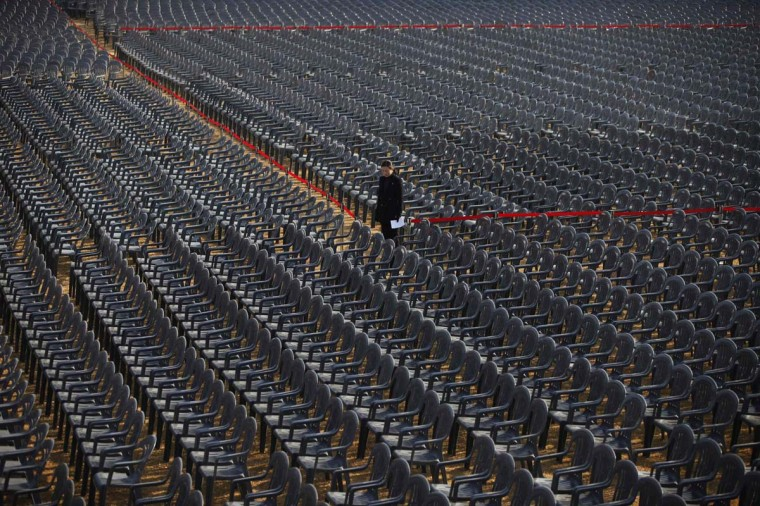 A worker stands among chairs prepared for the inauguration ceremony of South Korea's incoming president Park Geun-hye at the National Assembly in Seoul February 24, 2013. Park will take office as the country's 18th president on February 25 and about 70,000 people will participate in the ceremony. (Kim Hong-Ji/Reuters)