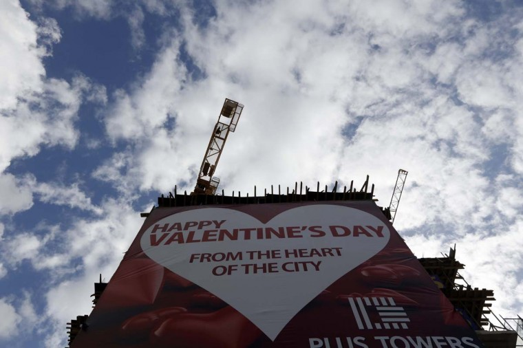 A huge banner is seen on a construction building in celebration of Valentine's Day in downtown Beirut, February 14, 2013. (Jamal Saidi/Reuters)