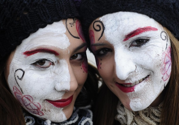 Revellers pose while parading the streets during a carnival in the village of Vevcani, some 170 km (106 miles) from the Macedonian capital Skopje, January 13, 2013. Vevcani village marks the Orthodox St. Vasilij Day annually with a carnival that features a 1,400-year-old celebration with pagan roots. The highlights of the carnival include a political satire where masked villagers act out current events. (Ognen Teofilovski/Reuters)