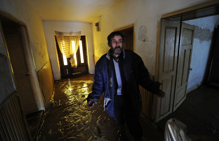A man gestures as he wades through floodwater in his house in Murtino, 180 km east of Skopje. One man drowned and several hundred homes in Macedonia were flooded on Tuesday as two days of heavy rain drenched farmland and caused power outages in the Balkan country, authorities said. (Ognen Teofilovski/Reuters)