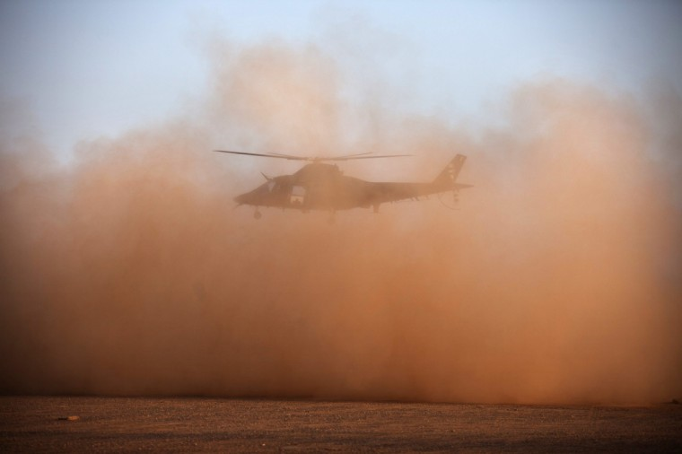 A Belgian medical evacuation helicopter takes off during a demonstration for Belgian Defence Minister Pieter De Crem at the French military headquarters at a Malian air base in Gao. (Joe Penney/Reuters)