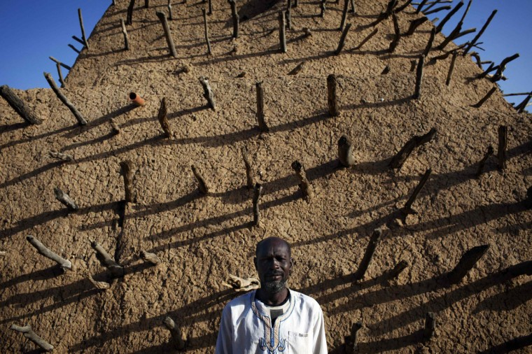 Security guard Oumar Tiemoko poses for a picture in front of the Askia Tomb in Gao. (Joe Penney/Reuters)