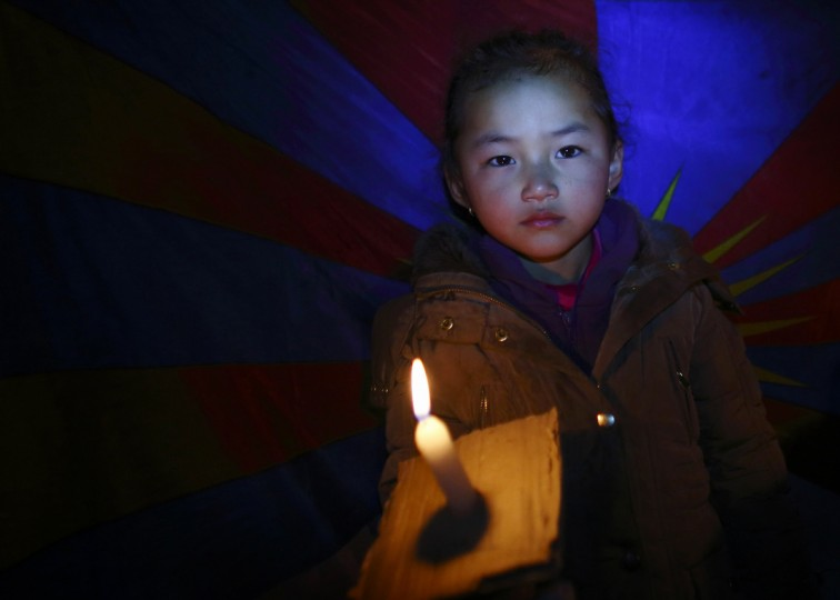 A Tibetan girl holding a lit candle takes part in a candlelight vigil to show solidarity to Tibetans who have self-immolated, and to mark the 100th anniversary of the 1913 Tibetan Proclamation of Independence, at the Tibetan Refugee Camp in Lalitpur. A Tibetan monk self-immolated on Wednesday at the premises of the Boudhanath Stupa in Kathmandu. (Navesh Chitrakar/Reuters)