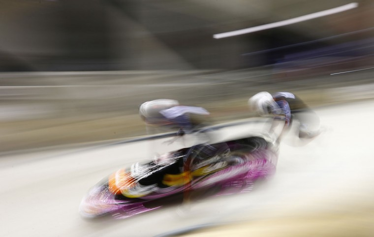 Germany's Sandra Kiriasis (L ) and Franziska Bartels start during the two-woman bobsleigh competition test event at the 'Sanki' siding center in Rosa Khutor, a venue for the Sochi 2014 Winter Olympics near Sochi. The Sochi 2014 Winter Olympics opens on February 7, 2014. (Kai Pfaffenbach/Reuters)