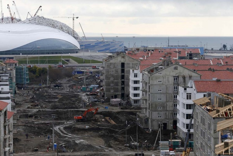 A general view shows the construction site of the Olympic athletes village in front of the Olympic Park with the Olympic stadium for the Sochi 2014 Winter Olympics in Adler, near Sochi February 18, 2013. (Kai Pfaffenbach/Reuters)