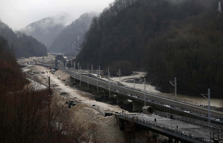 A general view shows the construction site of a bridge for the new highway and rail track connecting Sochi, the host city for the Sochi 2014 Winter Olympics, and the winter sport resort of Krasnaya Polyana, February 18, 2013. Construction will be completed by August 2013 according to organizers. The Sochi 2014 Winter Olympics opens on February 7, 2014. (Kai Pfaffenbach/Reuters)