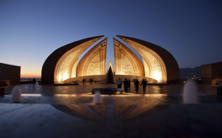 People walk past the Pakistan Monument at sunset in Islamabad. The monument, inaugurated in 2007, was built to represent the culture and civilization of the country and depicts the story of the Pakistan Movement, dedicated to those who sacrificed themselves for future generations. The four main petals of the monument represent the four provinces, while the three smaller petals represent the three territories. (Mian Khursheed/Reuters)