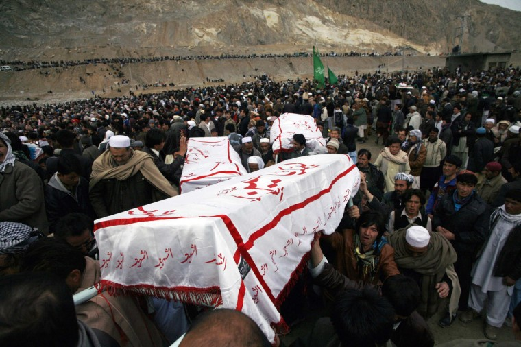 Shi'ite Muslims carry coffins of victims killed in Saturday's bomb attack, during a funeral in Quetta. Pakistani Shi'ites agreed to bury those killed in the most recent sectarian bombing, ending four days of protests, after the government said on Tuesday it had arrested 170 suspects linked to the attack. (Naseer Ahmed/Reuters)