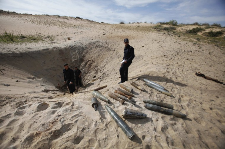 Members of the Hamas security forces prepare to destroy the remains of ordnance from an eight-day conflict between Israel and the Palestinians in 2012, in Rafah in the southern Gaza Strip. (Ibraheem Abu Mustafa/Reuters)