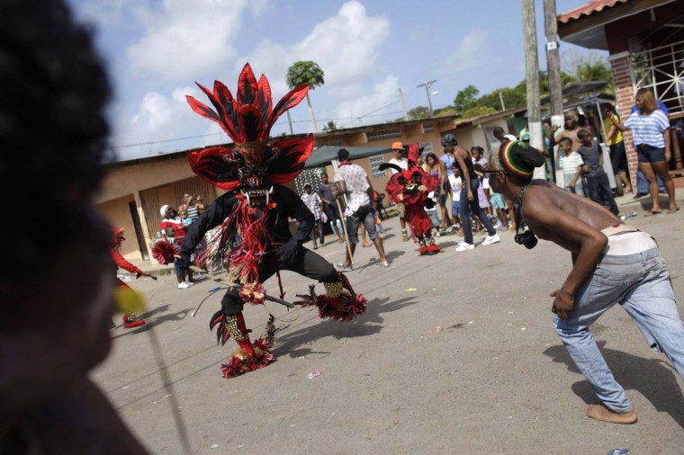 A man dressed up as the devil 'tortures' a participant with a whip during the 'Congos y Diablos' or Congos and Devils ritual celebration in Nombre de Dios, 81 miles from Panama City February 13, 2013. The Congos symbolize the black slaves while the Devils represent the Spanish colonizers. During Ash Wednesday annually, Congos, descendants of Africans who escaped slavery after their arrival in Panama during the Spanish colonization, would celebrate the triumph of good over evil with a wild mix of music and dance all along Panama's Caribbean coast. (Carlos Jasso/Reuters)