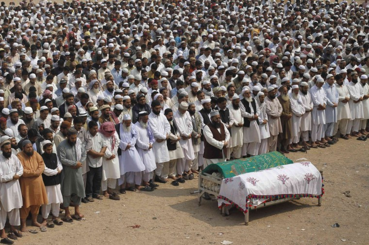 Supporters of Jamiat-Ulema-e-Islam (JUI), one of the largest Sunni political parties, and Ahl-i-Sunnat Wal Jaaat (ASWJ), a political and religious group, attend a funeral prayer for two of their workers who were shot by unidentified gunmen a day earlier, in Karachi. At least eight persons, including four activists from ASWJ, were killed and seven others injured, while vehicles were torched, in different areas of the metropolis amid the strike called by Shia Ulema Council, Majlis-e-Wahdat-e-Muslimeen and other organizations against the Quetta blast, local media reported. (Athar Hussain/Reuters)