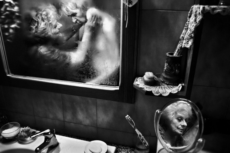 #12: Fausto Podavini of Italy has won the first prize in the Daily Life Stories category of the World Press Photo Contest 2013 with the series 'Mirella.' The picture shows Mirella taking care of her husband Luigi, who suffers from Alzheimer's disease, in Rome, taken on June 1, 2010 and distributed by the World Press Photo Foundation February 15, 2013. (Fausto Podavini/World Press Photo/Handout/Reuters)