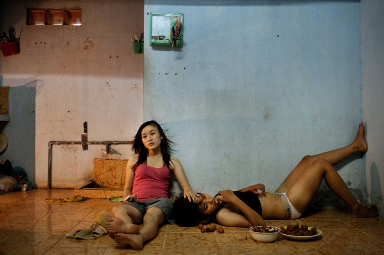 #10: Maika Elan of Vietnam, a photographer working for Management of StoryTellers MoST, has won the first prize in the Contemporary Issues Stories category of the World Press Photo Contest 2013 with the series 'The Pink Choice, Vietnam.' The picture shows Phan Thi Thuy Vy and Dang Thi Bich Bay, who have been together for one year, watching television to relax after studying at school in Da Nang, taken on June 22, 2012 and distributed by the World Press Photo Foundation February 15, 2013. (Maika Elan/MoST/World Press Photo/Handout/Reuters)