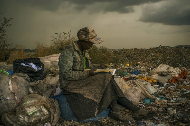 #9: Micah Albert of the U.S., a photographer working for Redux Images, has won the first prize in the Contemporary Issues Single category of the World Press Photo Contest 2013 with this picture of a woman pausing in the rain as she works as a trash picker at a 30-acre dump in Nairobi, taken on April 3, 2012 and distributed by the World Press Photo Foundation February 15, 2013. (Micah Albert/Redux Images/Handout/Reuters)