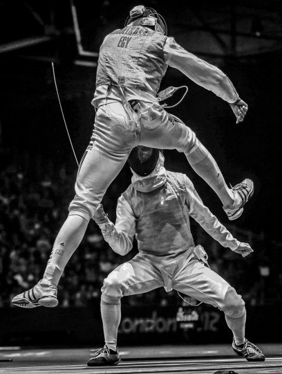 #7: Sergei Ilnitsky of Russia, a photographer working for the European Pressphoto Agency, has won the second prize in the Sports Action Stories category of the World Press Photo Contest 2013 with the series 'The Golden Touch - Fencing at the Olympics.' The picture shows Alaaeldin Abouelkassem of Egypt (top) in action against Peter Joppich of Germany during their Men's Foil Individual Round 16 at the London 2012 Olympic Games in London, taken on July 31, 2012 and distributed by the World Press Photo Foundation February 15, 2013. (Sergei Ilnitsky/European Pressphoto Agency/World Press Photo/Handout/Reuters)