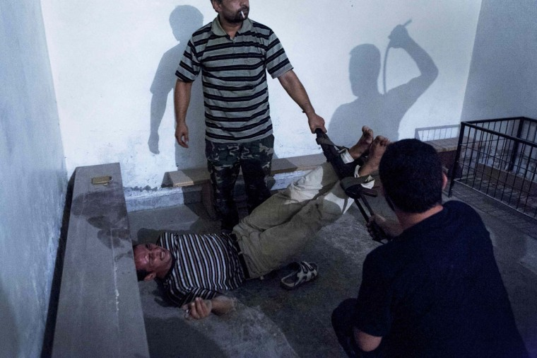 #2: Emin Ozmen of Turkey has won the second prize in the Spot News Single category of the World Press Photo Contest 2013 with this picture of Syrian opposition fighters interrogating and torturing an informant in Aleppo taken on July 31, 2012 and distributed by the World Press Photo Foundation February 15, 2013. (Emin Ozmen/World Press Photo/Handout/Reuters)