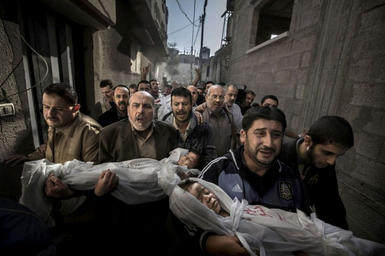 #1: Paul Hansen of Sweden, a photographer working for the Swedish daily Dagens Nyheter, has won the World Press Photo of the Year 2012 with this picture of a group of men carrying the bodies of two dead children through a street in Gaza City taken on November 20, 2012 and distributed by the World Press Photo Foundation February 15, 2013. Jury member Mayu Mohanna said about the photo: 'The strength of the picture lies in the way it contrasts the anger and sorrow of the adults with the innocence of the children. It's a picture I will not forget.' (Paul Hansen/Dagens Nyheter/World Press Photo/Handout/Reuters)