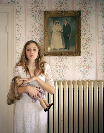 #13: Ilona Szwarc of Poland, a photographer working for Redux Images, has won the third prize in the People - Observed Portraits Single category of the World Press Photo Contest 2013 with this picture of Kayla posing with her lookalike doll in front of a portrait of her ancestors in Boston, Massachusetts, taken on February 19, 2012 and distributed by the World Press Photo Foundation February 15, 2013. (Ilona Szwarc/Redux Images/World Press Photo/Handout/Reuters)