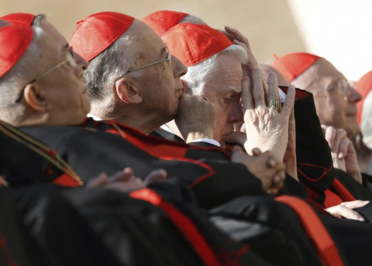 Cardinal Bernard Law (C) of the U.S. attends the last general audience of Pope Benedict XVI in St Peter's Square at the Vatican February 27, 2013. The weekly event which would normally be held in a vast auditorium in winter, but has been moved outdoors to St. Peter's Square so more people can attend. (Alessandro Bianchi/Reuters photo)