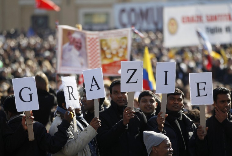 "A sign reading ""Thank you"" in Italian is held in St Peter's Square as Pope Benedict XVI holds his last general audience at the Vatican February 27, 2013. The weekly event which would normally be held in a vast auditorium in winter, but has been moved outdoors to St. Peter's Square so more people can attend. The pope has two days left before he takes the historic step of becoming the first pontiff in some six centuries to step down instead of ruling for life. (Max Rossi/Reuters photo)"