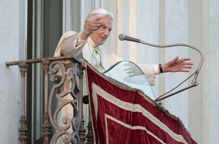 Pope Benedict XVI waves as he appears for the last time at the balcony of his summer residence in Castelgandolfo, south of Rome, February 28, 2013. (Max Rossi/Reuters)