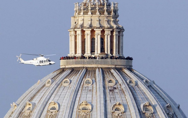 "A helicopter carrying Pope Benedict XVI takes off from inside the Vatican on its way to the papal summer residence at Castelgandolfo, February 28, 2013. Pope Benedict slips quietly from the world stage on Thursday after a private last goodbye to his cardinals and a short flight to a country palace to enter the final phase of his life ""hidden from the world"". (Alessandro Bianchi/Reuters)"