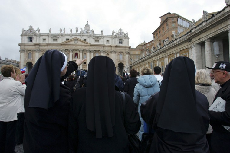 A nun points to a chimney above the Sistine Chapel in the Vatican, as white smoke rises, indicating a new pope has been elected: German Cardinal Joseph Ratzinger as Pope Benedict XVI. (Kimimasa Mayama/Reuters)