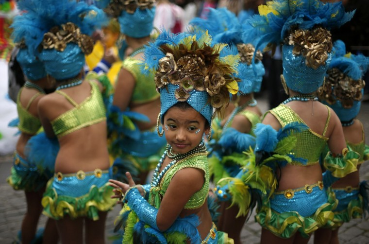 Children wait to take part in a samba parade during the carnival in Sesimbra village February 10, 2013. (Rafael Marchante/Reuters)