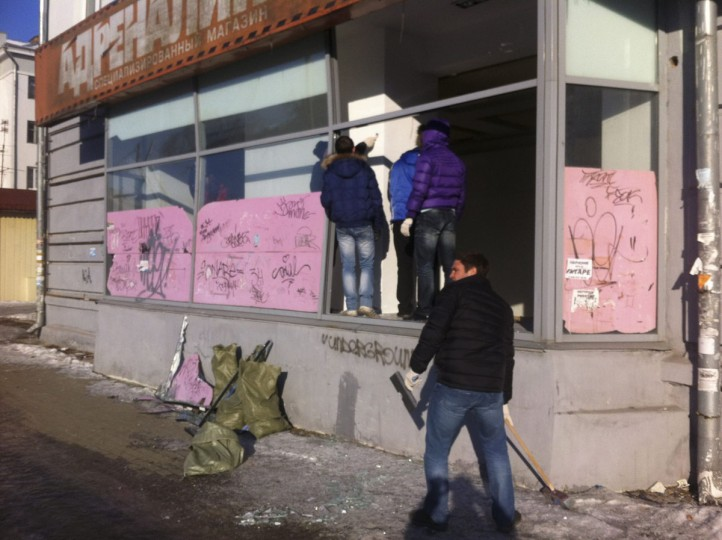 People look at damage to a shop in the Urals city of Chelyabinsk February 15, 2013. Buildings were damaged after a meteorite shot across the sky and exploded over central Russia on Friday. (Andrei Kuzmin/Reuters)