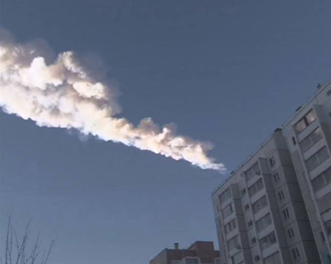 The trail of a falling object is seen above a residential apartment block in the Urals city of Chelyabinsk, in this still image taken from video shot on February 15, 2013. A powerful blast rocked the Russian region of the Urals early on Friday with bright objects, identified as possible meteorites, falling from the sky, emergency officials said. (OOO Spetszakaz/Reuters)