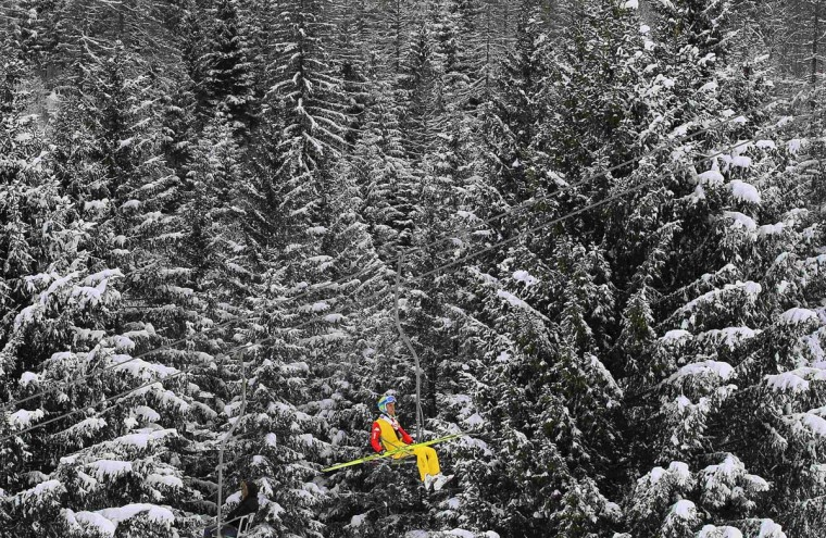 A competitor in the Nordic Combined Team Gundersen Competition uses a lift to reach the start area of the jump at the Nordic Ski World Championships in the northern mountain resort of Predazzo in Val di Fiemme February 24, 2013. (Yves Herman/Reuters)
