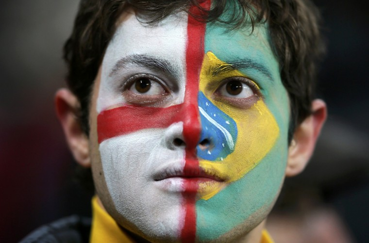 A football fan's face is painted with the flags of England and Brazil before the international friendly soccer match at Wembley stadium in London. (Stefan Wermuth/Reuters)