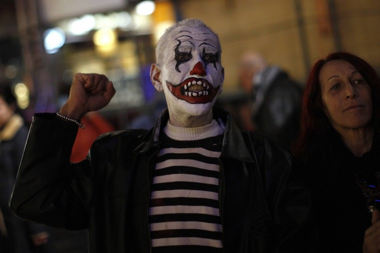 A demonstrator who is dressed up for the carnival shouts slogans during a protest against political corruption at La Constitucion Square in Malaga, southern Spain, February 2, 2013. (Jon Nazca/Reuters)