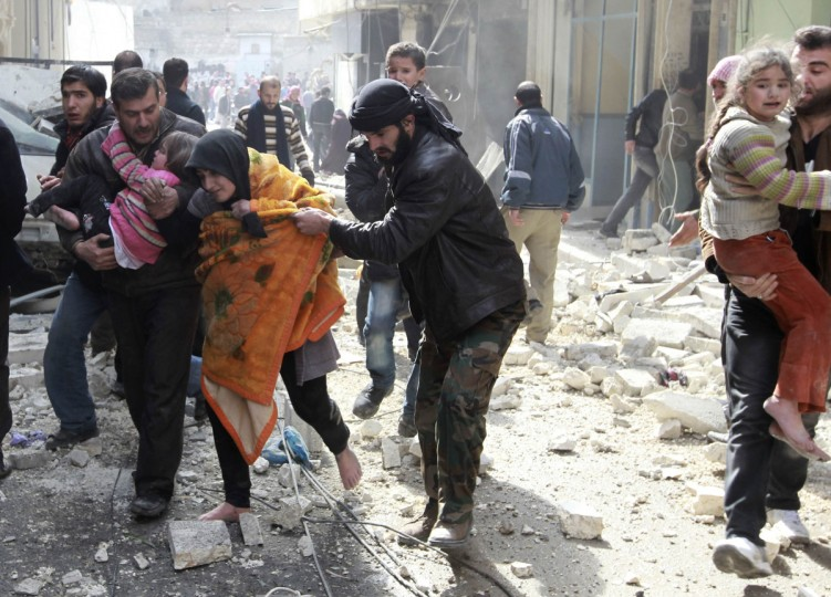 A Free Syrian Army fighter helps a family after a jet missile hit the al-Myassar neighborhood of Aleppo. (Muzaffar Salman/Reuters)