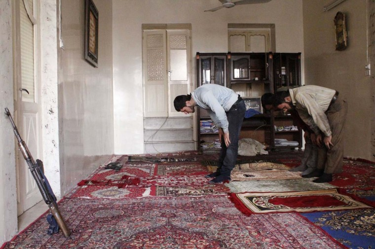 Members of the Free Syrian Army pray in a house in Aleppo February 23, 2013. (Hamid Khatib/Reuters)