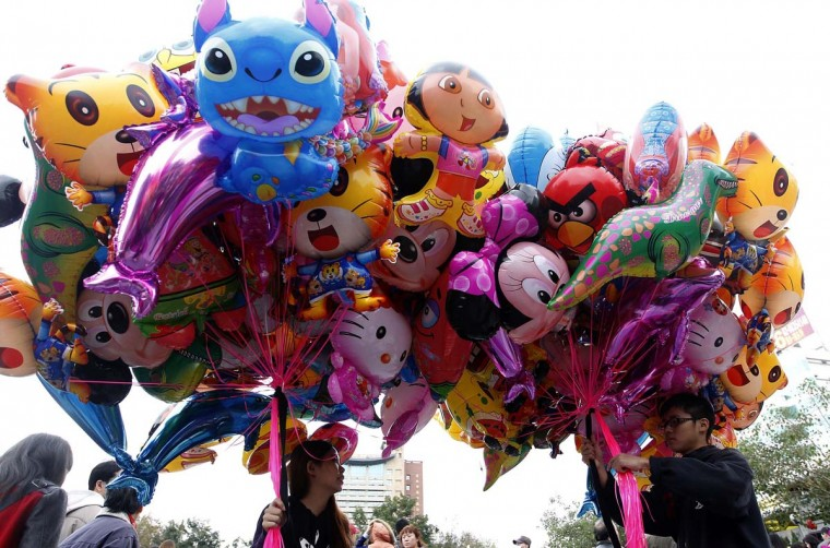 Vendors sell balloons in front of Lungshan temple during Chinese Lunar New Year celebrations in Taipei February 10, 2013. The Lunar New Year, also known as the Spring Festival, begins on February 10 and marks the start of the Year of the Snake, according to the Chinese zodiac. (Pichi Chuang/Reuters)