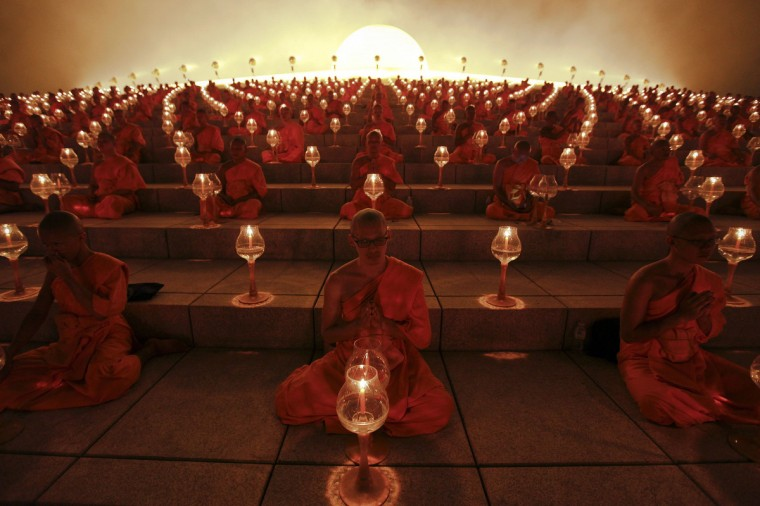 Buddhist monks pray at the Wat Phra Dhammakaya temple in Pathum Thani province, north of Bangkok on Makha Bucha Day. Makha Bucha Day honors Buddha and his teachings, and falls on the full moon day of the third lunar month. (Kerek Wongsa/Reuters)