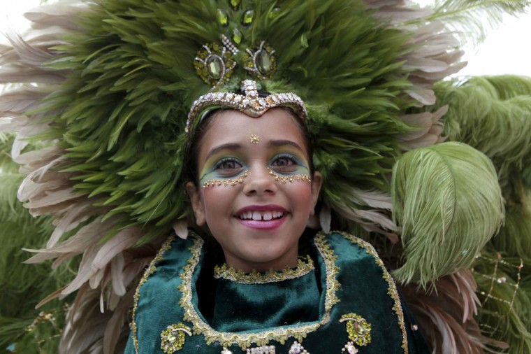 A participant takes part in a masquerade parade at the Trinidad and Tobago Red Cross Society's Children Carnival at Queen's Park Savannah, Port of Spain February 2, 2013. (Andrea de Silva/Reuters)