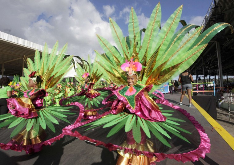 "Participants from the ""Lost in Paradise"" group take part in a masquerade parade at the Trinidad and Tobago Red Cross Society's Children Carnival at Queen's Park Savannah, Port of Spain February 2, 2013. (Andrea de Silva/Reuters)"