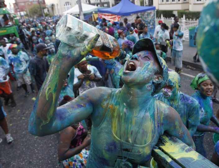 "A reveller drinks during J'Ouvert celebrations, or ""daybreak celebrations"" in the capital city Port of Spain February 11, 2013. Revellers bathe themselves in chocolate, mud, oil and paint as they depict devils, demons, monsters and imps during the celebrations, which marks the start of the two-day Trinidad Carnival street parade.(Andrea De Silva/Reuters)"