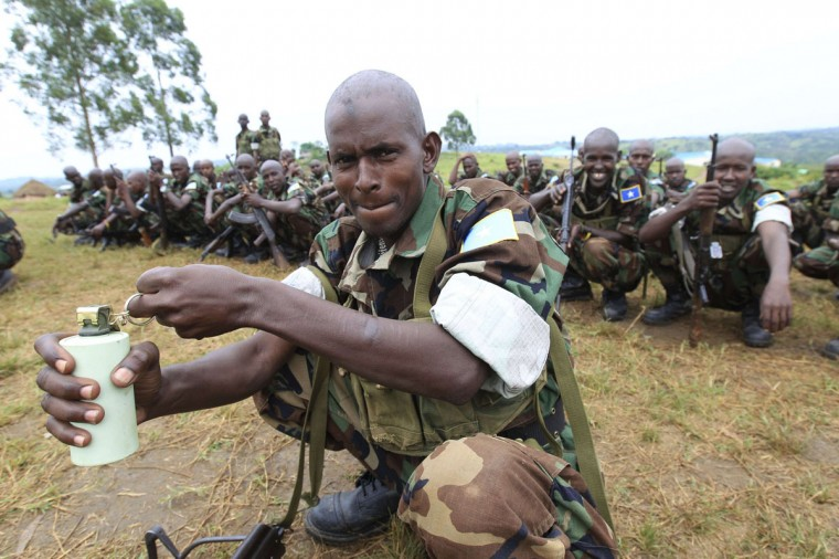 A Somali government soldier, trained by the European Union Training Mission (EUTM) team, poses with a stun grenade as he waits with other graduates for their passing out ceremony at Bihanga army training camp, 368 km (230 miles) west of Uganda's capital Kampala. Five hundred fifty one Somali soldiers, trained for seven months in urban combat skills by the EUTM, graduated on Friday and are now ready for deployment back in their home country, according to a media release by the EU Kampala offices. (James Akena/Reuters)